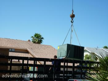 Starting To Crane The New Rheem RRPL Unit In Place