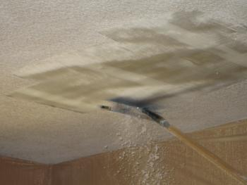 Close-Up Of Scraping Ceiling Texture