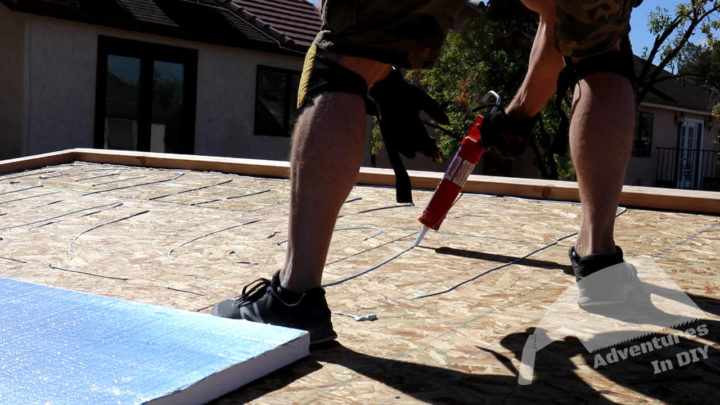 Putting Rigid Foam Adhesive on Roof Deck