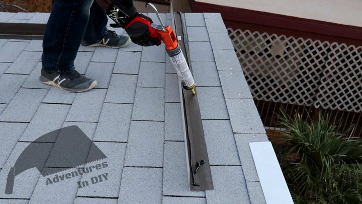 Putting Flashing Adhesive on the Side of the Flashing that will Sit on the Shingles
