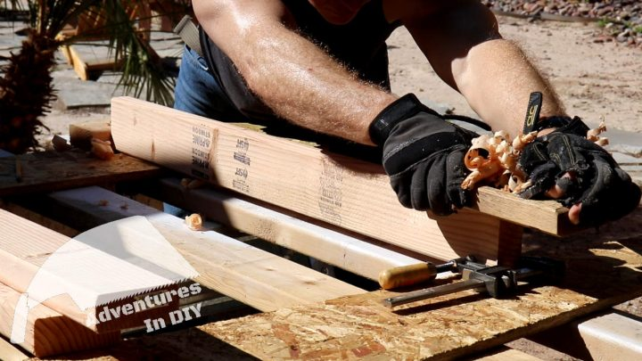 Using a Hand Plane to Angle the Bottom 2x4 of the Window