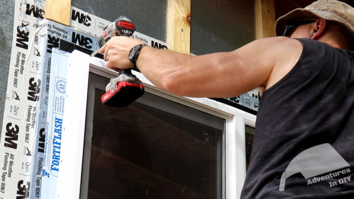 Putting Screws in the Top Corners to Hold the Window in Place while Shimming