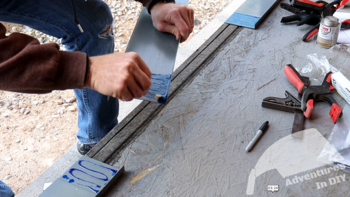 Applying PVC Cement to the Sides and the Center of the Sill Pan