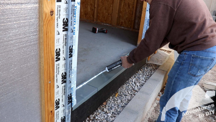 Laying a Bead of Caulk Along the Interior Edge of the Sill Pan