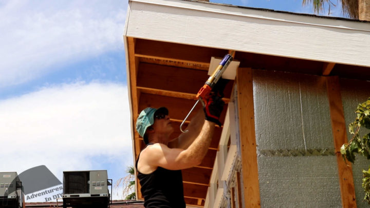 Applying Construction Adhesive Before Installing Shiplap